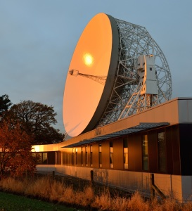 The SKA Organisation Headquarters, at Jodrell Bank Observatory near Manchester, UK, and the Lovell Telescope in the background. Credit: SKA, R. Millenaar (ASTRON/SKA)