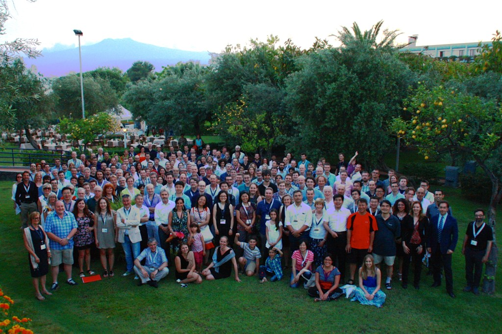 Official photo of the Advancing Astrophysics with the SKA conference held in Giardini Naxos June 8-13 in the gardens of the Atahotel Naxos Beach, with Mount Etna in the background.