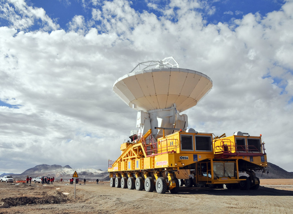 An ALMA antenna en route from the Operations Support Facility to the plateau of Chajnantor for the first time. The ALMA transporter vehicle carefully carries the state-of-the-art antenna, with a diameter of 12 metres and a weight of about 100 tons, on the 28 km journey to the Array Operations Site, which is at an altitude of 5000 m. The antenna is designed to withstand the harsh conditions at the high site, where the extremely dry and rarefied air is ideal for ALMA's observations of the universe at millimetre- and submillimetre-wavelengths.