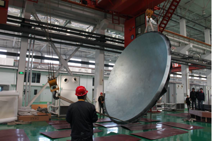 The 5-m wide DVA-C subreflector being lifted up from its mould. Made of carbon fibre reinforced polymers and weighing 248 kg, the subreflector is the 1st major part of China's prototype dish antenna for the SKA.