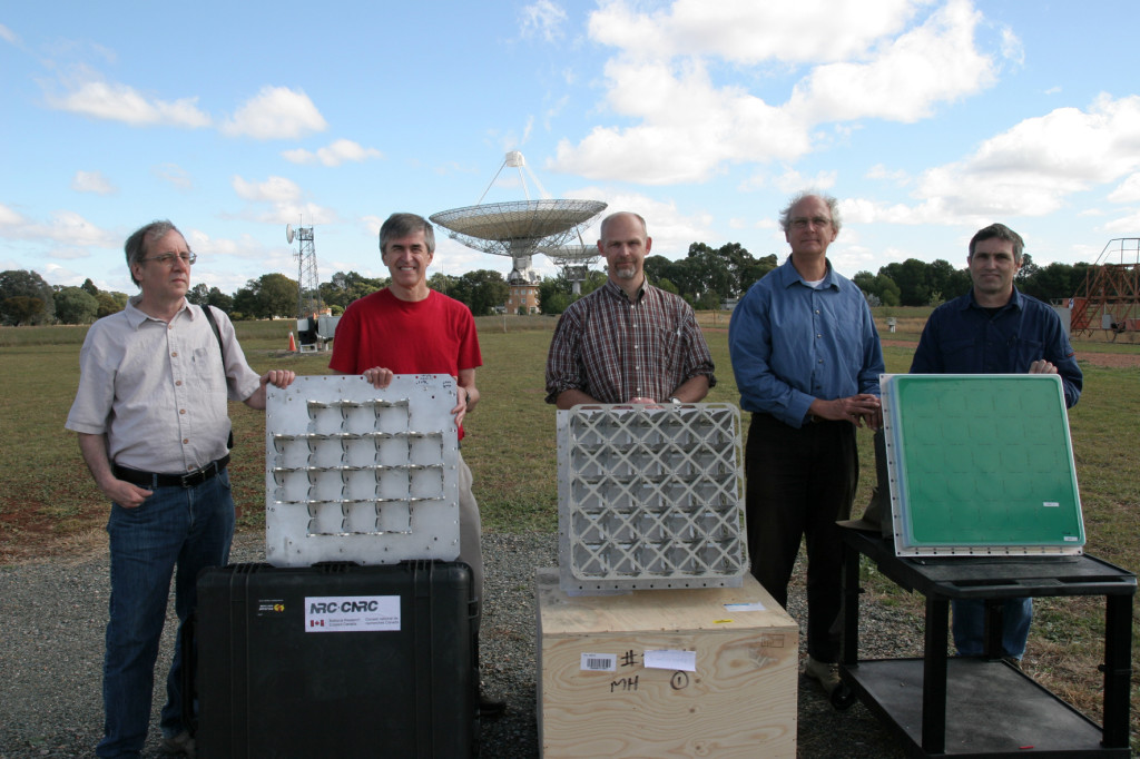The teams from NRC, ASTRON and CSIRO with their respective Phased Array Feed designs in front of the Parkes telescope