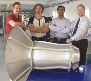 The Band 1 feed in the electronics lab at Onsala Space Observatory. Standing behind the feed horn from the left: Joel Schleeh (Low Noise Factory) with Onsala Space Observatory engineers Magnus Dahlgren, Bhushan Billade (technical project manager) and Jens Dahlström. (Credit: SKA Organisation)