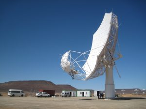 SKA-MPI prototype dish on the South African site, with a clear blue sky behind it.