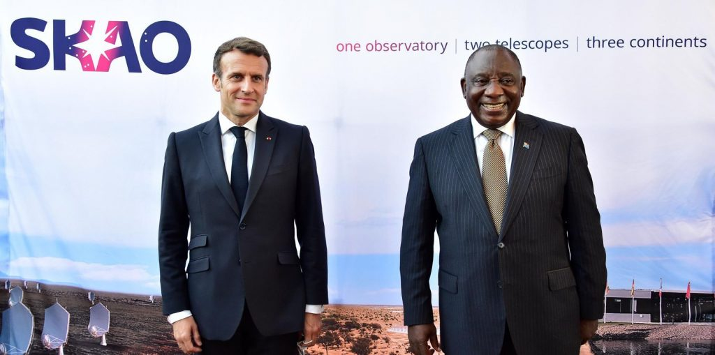 French President Emmanuel Macron and South African President Cyril Ramaphosa in front of an SKAO banner.