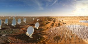 Composite image of the SKA combining all elements in South Africa and Australia. This image blends photos of real hardware already on the ground on both sites with artist's impressions of the future SKA antennas. From left: artist's impression of the future SKA dishes blend into the existing precursor MeerKAT telescope dishes in South Africa. From right: artist's impression of the future SKA-Low stations blends into the existing AAVS2.0 prototype station in Western Australia.