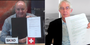 SKAO Director-General Prof. Philip Diamond and EPFL President Prof. President Prof. Martin Vetterli holding the cooperation agreement during an online ceremony.